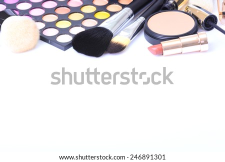 makeup brush and cosmetics, on a white background - stock photo