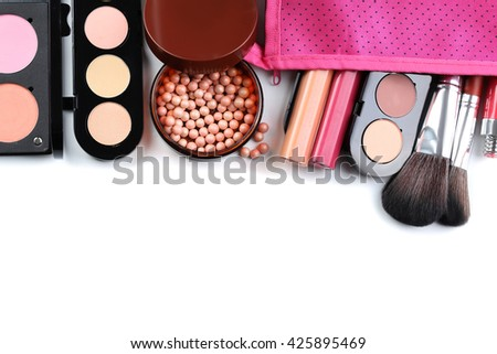 Makeup brush and cosmetics on a white background - stock photo