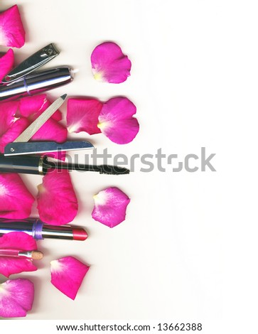 makeup brush and cosmetics with rose petals, on a white background isolated - stock photo