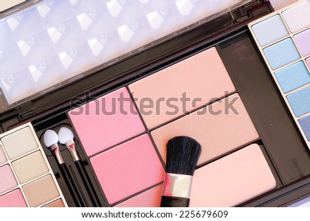 makeup brush and make-up eye shadows - stock photo