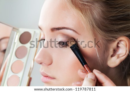 makeup brush eyeshadow on eyelid - stock photo
