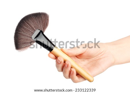 Makeup brush in hand isolated on a white background - stock photo