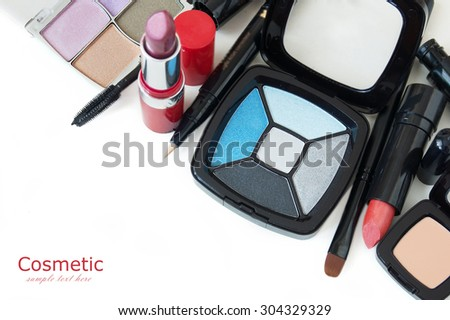 Makeup brush, lipstick and other cosmetics isolated on a white background - stock photo