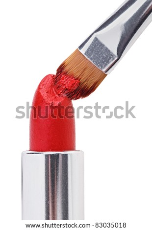 Makeup brush pushed in on red lipstick, isolated on white - stock photo