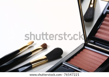 Makeup brushes and make-up tender blush - stock photo