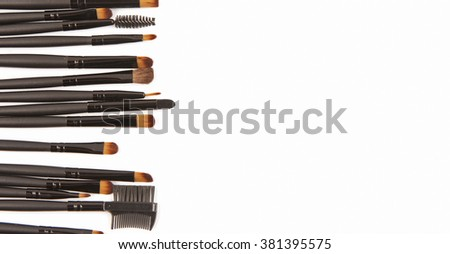 Makeup brushes isolated on white background with space for your text