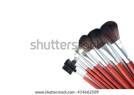 Makeup brushes set on a white background - stock photo