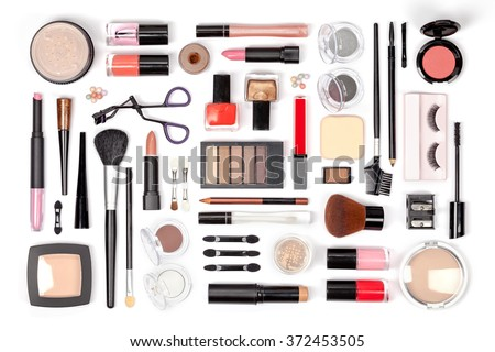 makeup cosmetics, brushes and other essentials on white background top view. beauty flat lay concept in red colors - stock photo