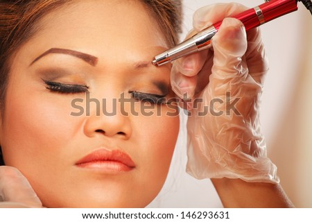 Beauty parlor stock images royalty free images vectors for Japanese tattoo eyeliner