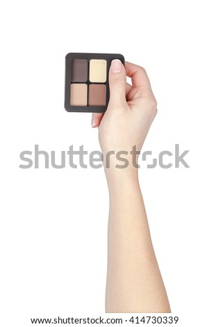 makeup eyeshadow palette in a hand isolated on white background. cosmetics product