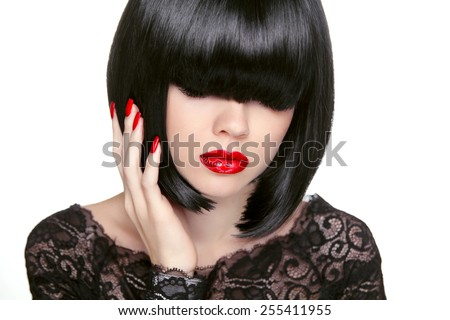 Makeup. Fashion bob Haircut. Hairstyle. Long Fringe. Short Hair Style. Brunette girl with red lips isolated on white background - stock photo