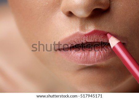 Makeup Lips. Closeup Of Beautiful Young Woman Applies Color Contour Lip Pen, Lip Liner. Girl Contouring Sexy Full Lips With Lip Pencil, Beauty Product. Cosmetics Concept. High Resolution Image