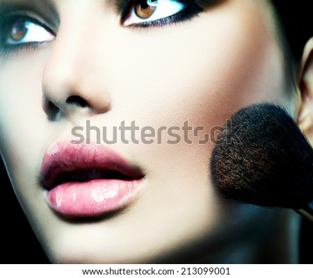 Makeup. Make-up Face. Big Make up brush. Beauty Woman. Makeup applying. Beautiful fashion model girl face closeup.  - stock photo