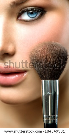 Makeup. Make-up Face. Big Make up brush. Makeup applying concept. Beautiful fashion model girl face closeup. Skin tone. Facial powder - stock photo