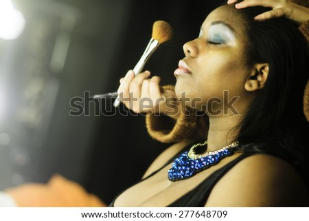 Makeup making of - stock photo