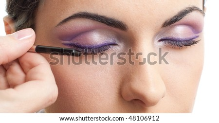 Makeup outline the eyes routine - stock photo