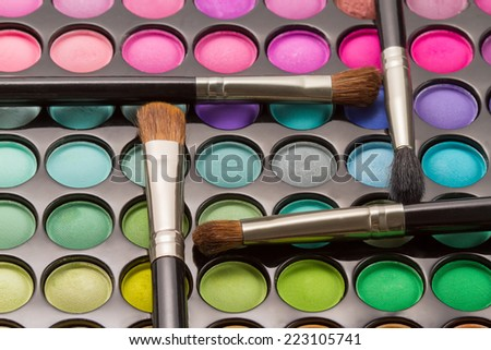 Makeup palette with makeup brushes. Shallow DOF - stock photo