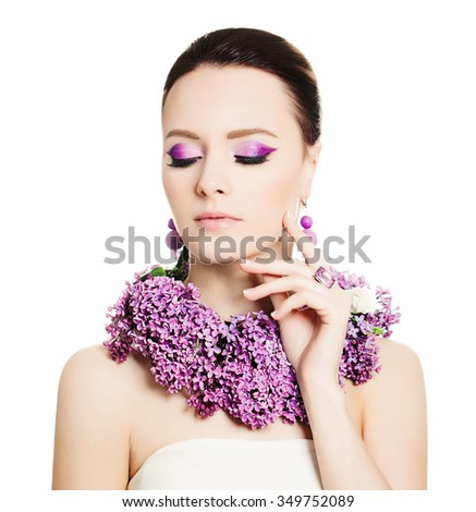 Makeup. Portrait of Woman with Bright Make-up and Flowers Isolated - stock photo