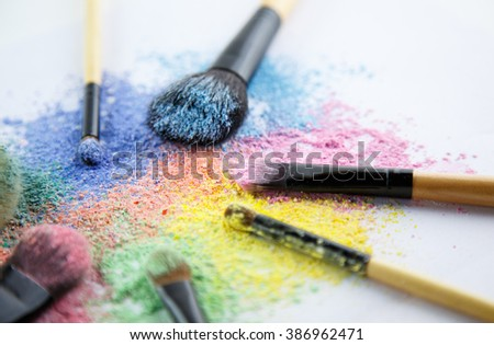 makeup powder and brush on white background, focused on pink brush
