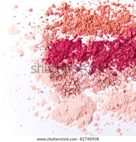 makeup powder in three colors on white background - stock photo