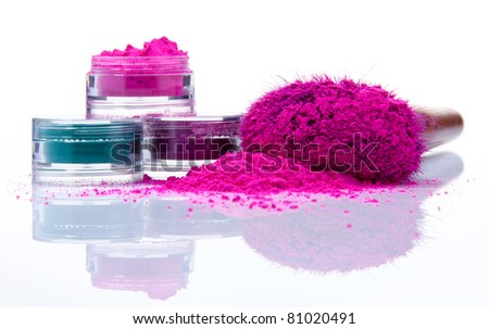 Makeup powder of different colors and brush - stock photo