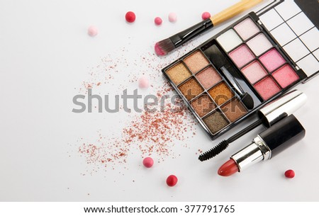 makeup products on white background - stock photo