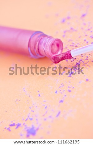 makeup shot of pink lipgloss - stock photo