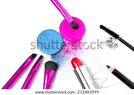 Makeup tools - brushes, eye shadows, lipstick, mascara and eyeliner - stock photo