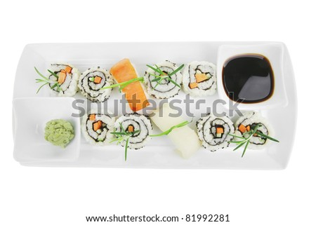 Maki Roll with Deep Fried Vegetables inside . on long white plate . isolated over white background . Japanese Cuisine - stock photo