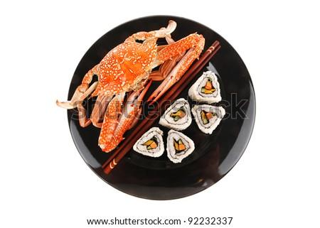 Maki Rolls and California rolls made of fresh raw Salmon, Tuna and Eel . on black dish with boiled crab . Maki Sushi and Nigiri - stock photo