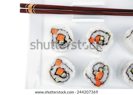 Maki Sushi - California Maki Roll made of fresh raw Salmon, Cream Cheese and Avocado inside. Served with wasabi . Isolated over white background on square plate - stock photo