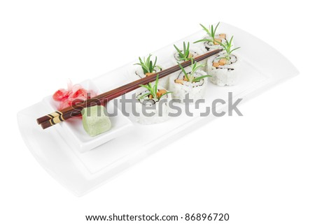 Maki Sushi - California Roll with Cucumber , Cream Cheese and Raw Salmon inside. Served with wasabi and ginger . on long white plate isolated over white background - stock photo