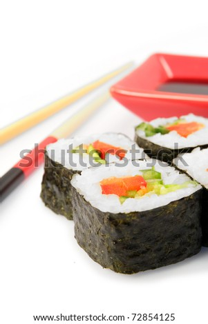 Maki sushi. Japanese cuisine on white