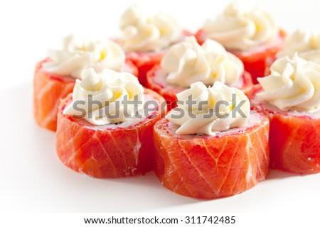 Maki Sushi - Philadelphia Roll made of Cream Cheese  inside. Fresh Raw Salmon outside - stock photo