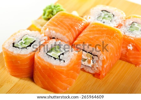 Maki Sushi - Roll made of Cream Cheese and Cucumber inside. Fresh Salmon outside - stock photo