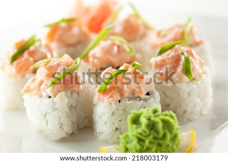 Maki Sushi - Roll topped with Sliced Spicy Salmon - stock photo