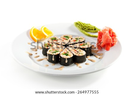 Maki Sushi - Roll with Chuka Seaweed, Sweet Pepper and Salad Leaf inside. Nori outside. Served with Nuts Sauce - stock photo