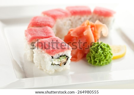 Maki Sushi - Roll with Cucumber and Cream Cheese inside. Topped with Tuna