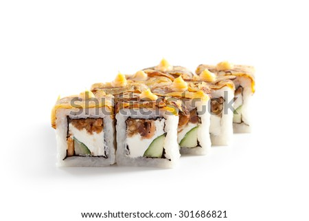 Maki Sushi - Roll with Fried Salmon, Cucumber and Cheese inside. Topped with Omelette - stock photo