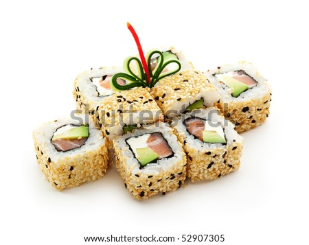 Maki Sushi - Roll with Smoked Salmon, Cream Cheese, Salad Leaf and Avocado inside. Sesame outside. - stock photo