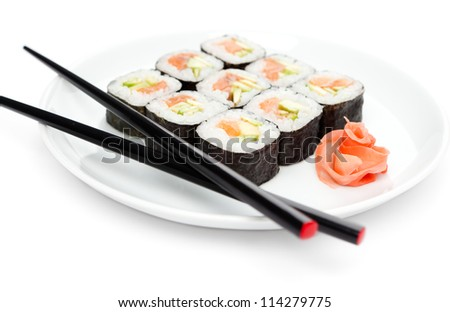 Maki sushi rolls on the plate with chopsticks, isolated on white - stock photo