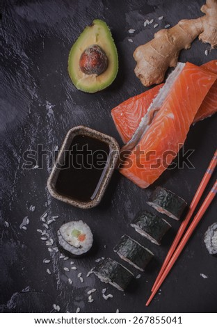 Maki sushi rolls with salmon and avocado on the vintage japanese plate  - stock photo