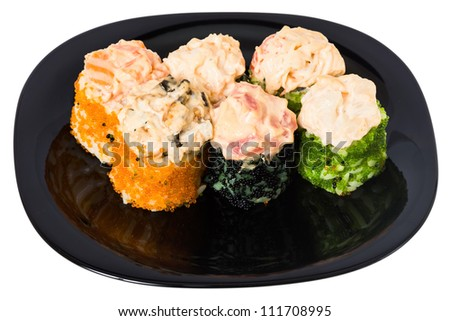 "Maki sushi with salmon, avocado, cucumber, Philadelphia cheese and caviar ""Tobiko"". On a black plate isolated on white background. - stock photo"