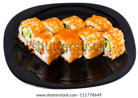 "Maki sushi with salmon, prawn, avocado, cucumber, Philadelphia cheese and red caviar ""Tobiko"". On a black plate isolated on white background. - stock photo"