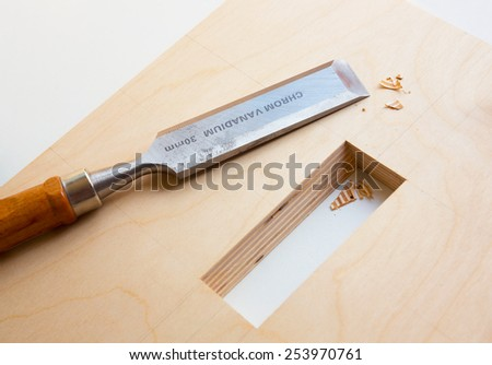 Making a component of wood furniture. Close-up photo - stock photo