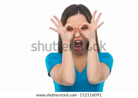 Making a face. Young woman making a face and grimacing while isolated on white