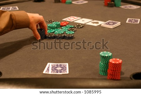 Making a large bet in a poker game - stock photo