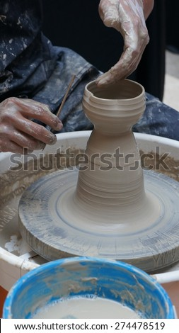 Making a new pot at workshop - stock photo