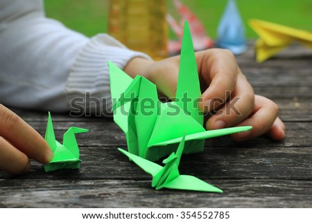 making a origami bird - stock photo