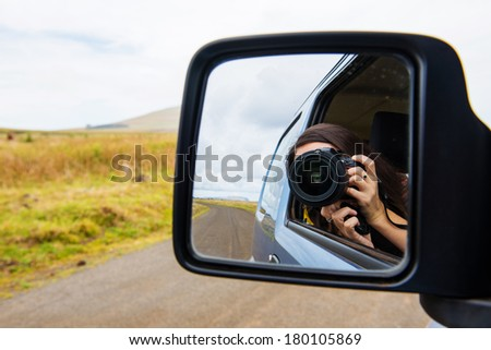 Making a picture from the car on the road - stock photo